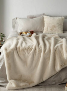 faux fur throw from simons on bed with faux suede on reverse