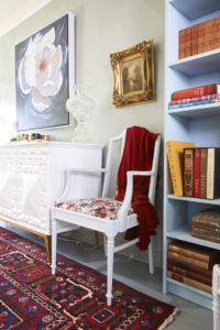 ikea bookscaes painted in pale blue and styled with vintage books and decor