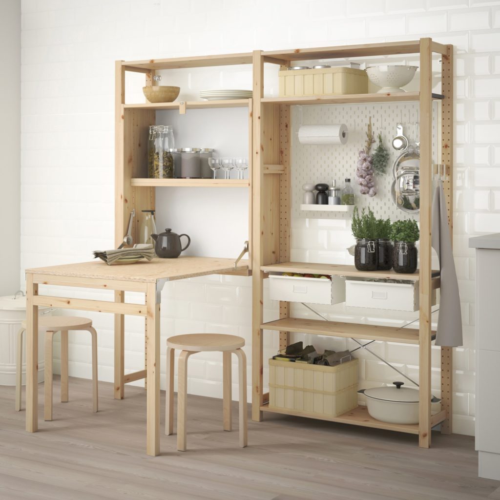small space kitchen with Ikea Ivar storage in uf=nfinished pibe and hanging accessories
