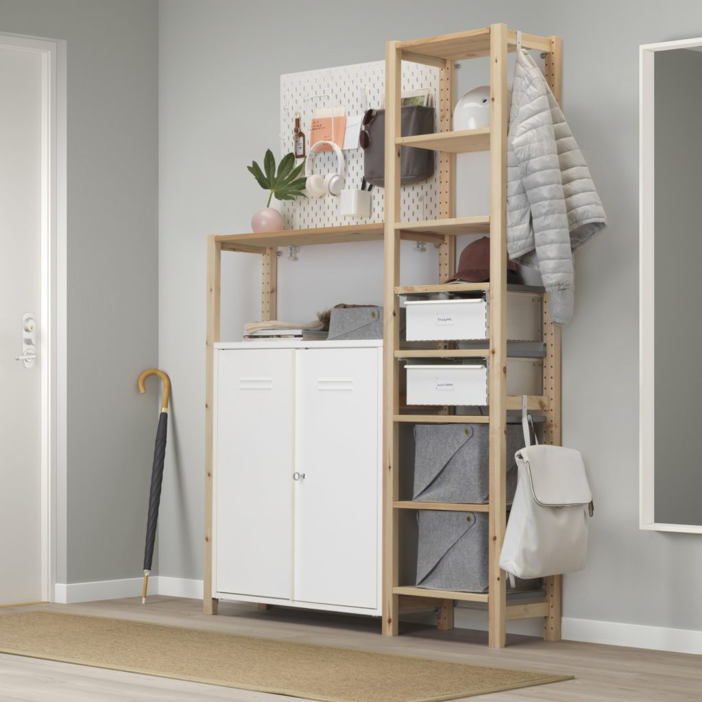 Ikea Ivar in a small hallway of an apartment with sisal runner and storage boxes and bins
