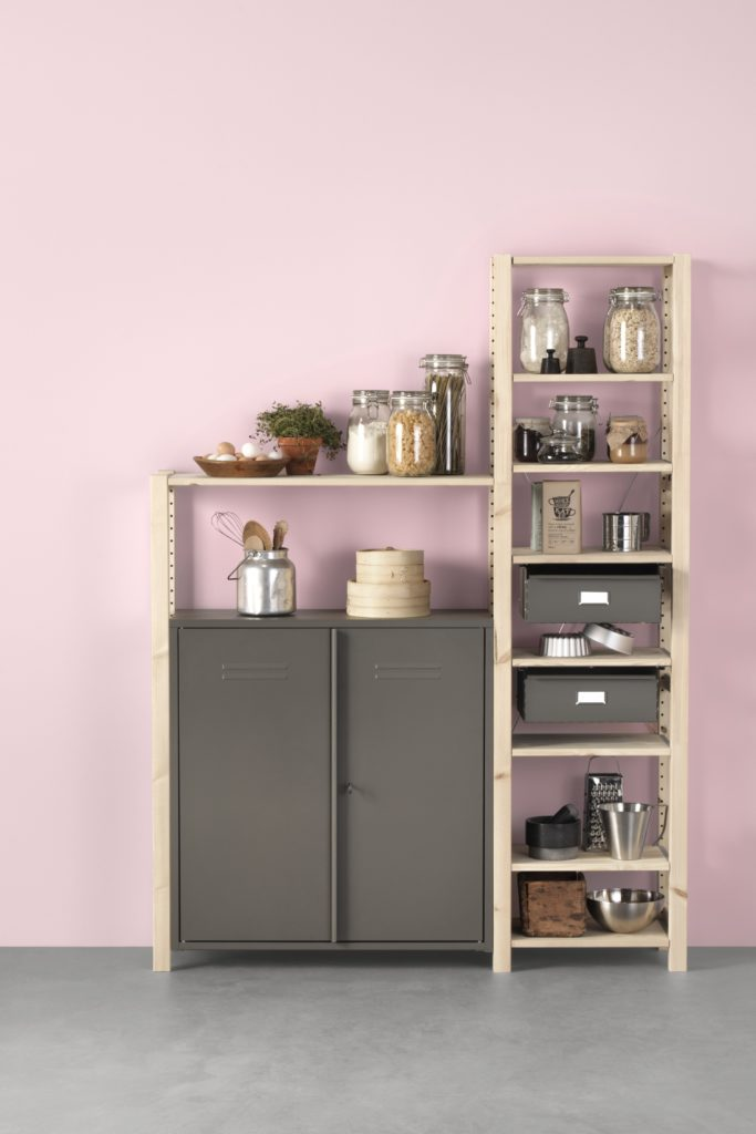 Ikea Ivar shelving in small kitchen against pink wall.