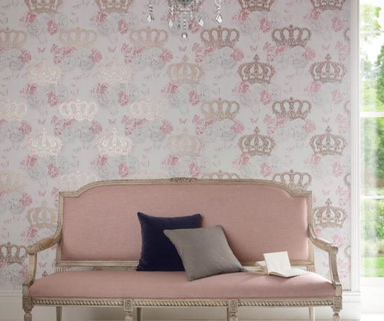 shot of pale pink sofa with graham and brown wallpaper in gold and pink crown pattern