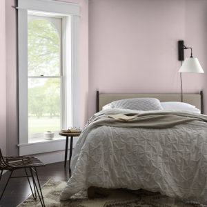 bedroom with mdoern design and pale pinks walls