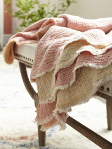 tight shot of pink wool throw on bench with tufts and nailbead trim from HomeSense
