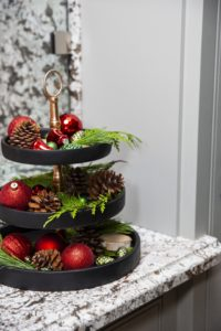 Black marble tray with holiday decorations