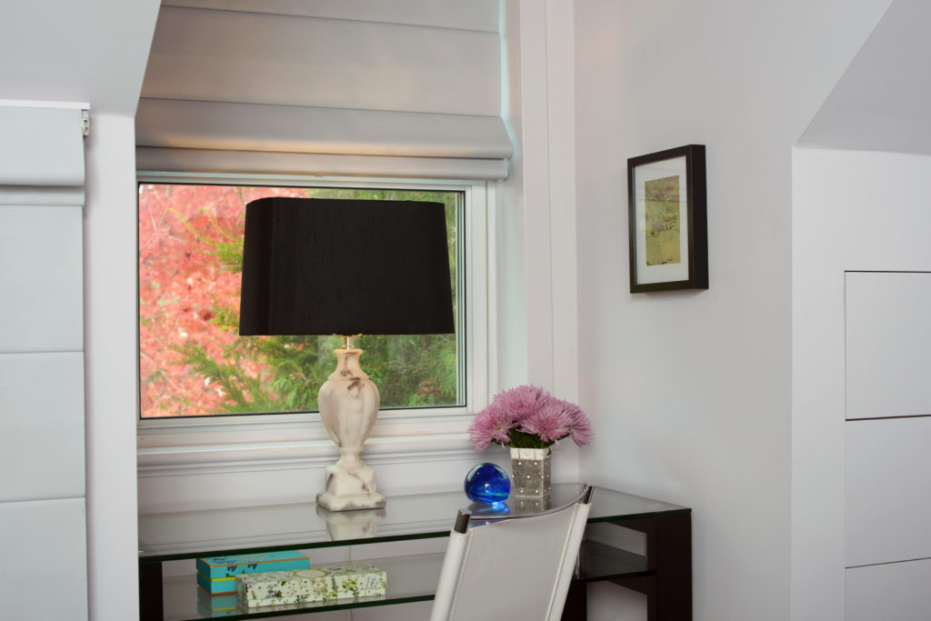 This small glass desk is perfect for a spare room, offering a convenient surface for work or grroming, and a second shelf to store travel items.