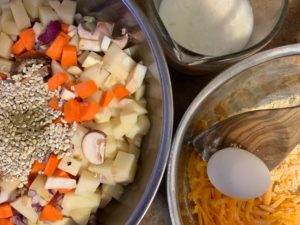 Chopped veg in stainless steel bowls with ingredients fro sage cheddar vegetarian cornbread.